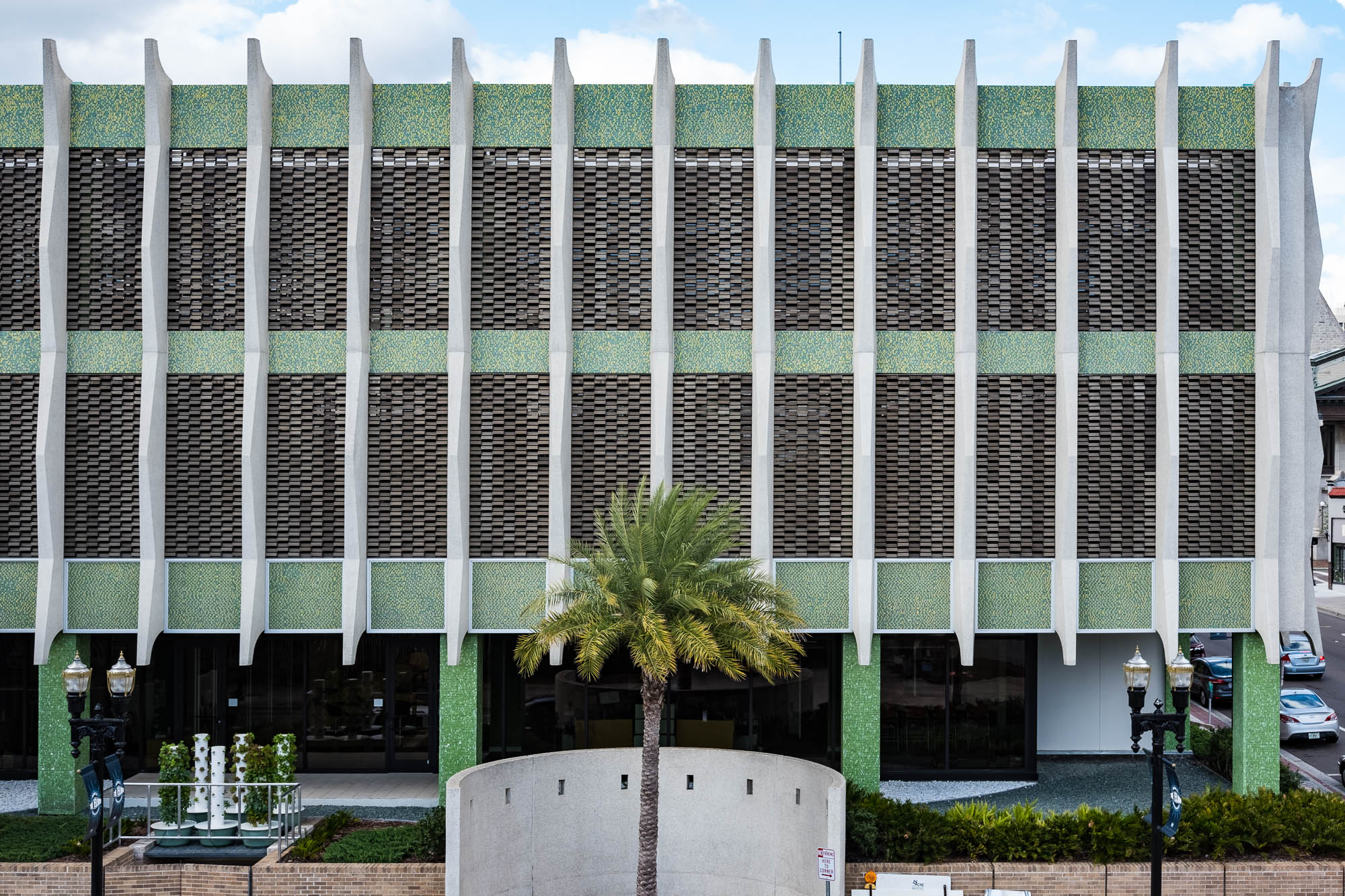 Image of the Haydon Burns Library, a modernist building with a green tiled facade and vertical fins.